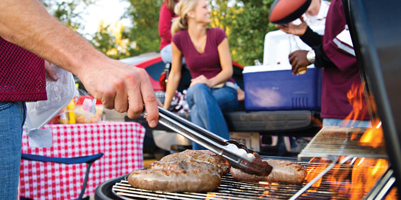 A group of people grilling outdoors