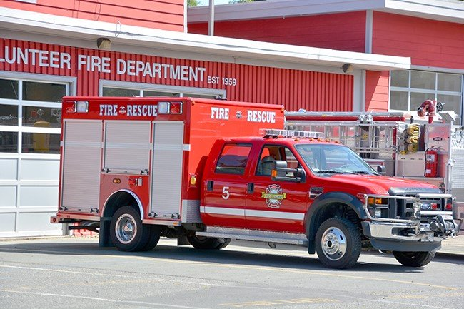 A fire and rescue truck outside a fire station