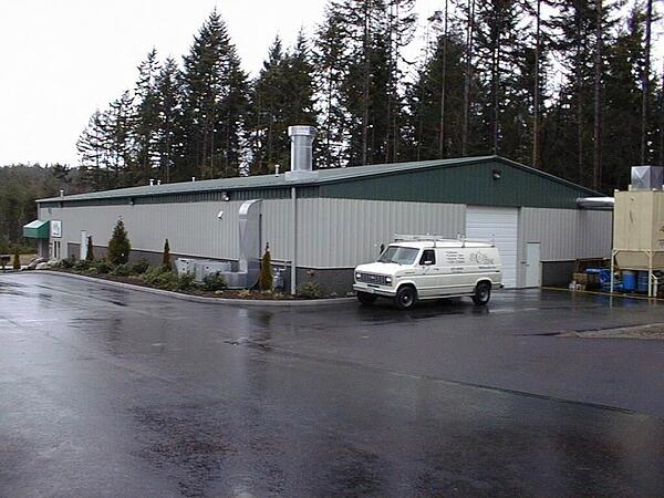 The exterior of a construction class 3 building with metal siding and roof