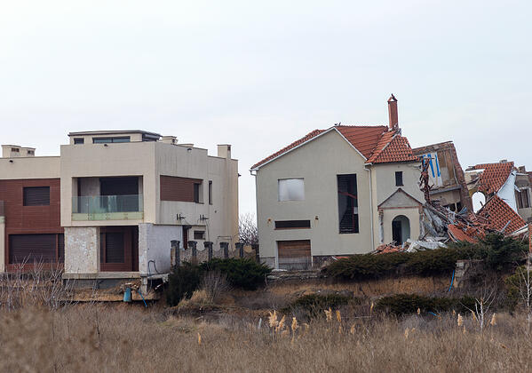 Homes severely damaged by an earthquake