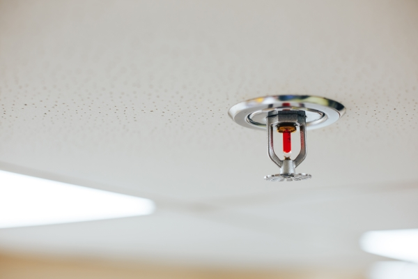 Automatic fire sprinkler system head in a commercial building