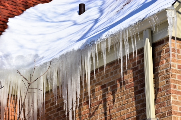 An ice dam forms on a home