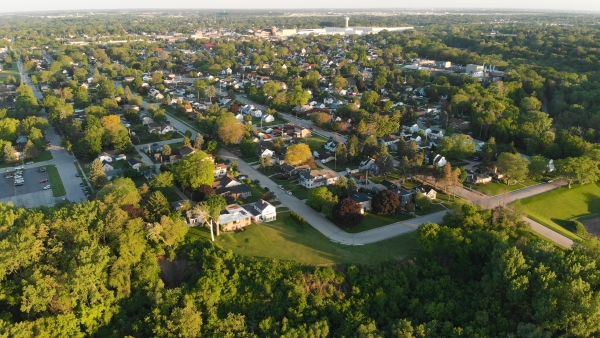 Aerial shot of a suburban area with homes and businesses