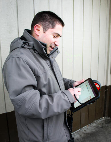 A WSRB property analyst inspecting a building.