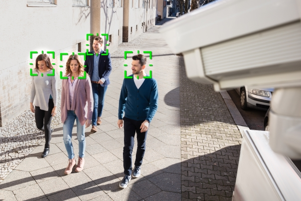 People walking down a street and being tracked by facial recognition technology