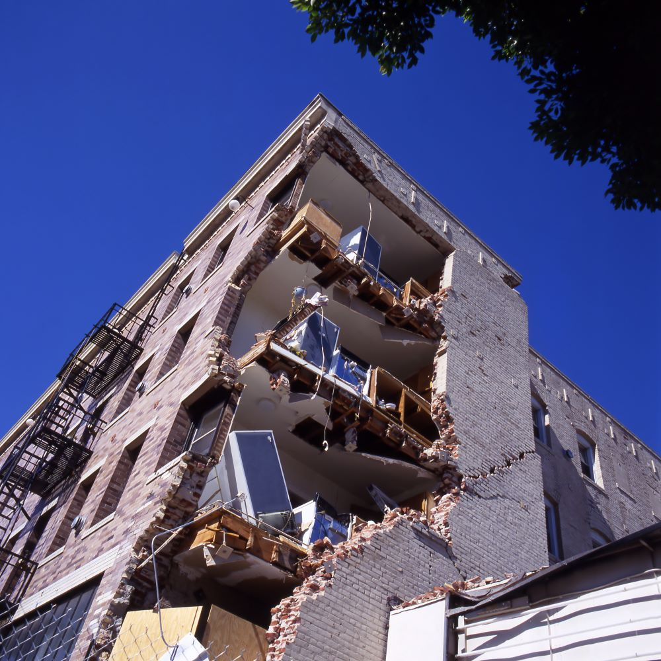 An apartment building damaged by an earthquake