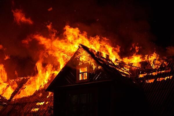 A home burning in a wildfire