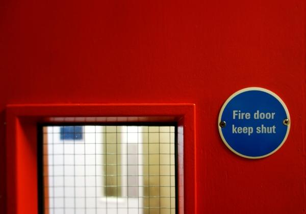 An interior fire door with a keep shut sign